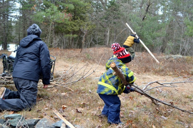 Everyone helps when building a fire
