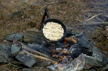 Cooking bannock 'round a fire